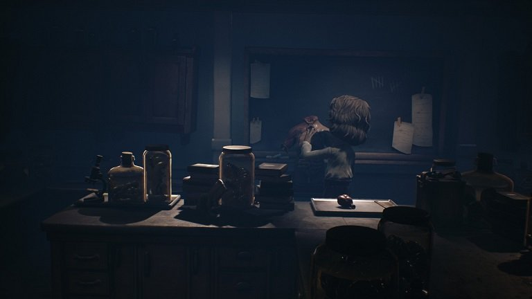Little Nightmares 2 Game Guide - Mono hides behind objects on table