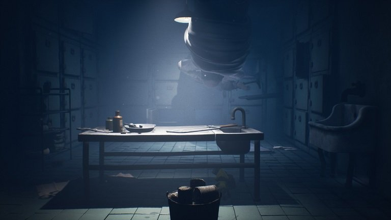 Little Nightmares II Hospital Walkthrough Guide – Mono and Six hiding under the table