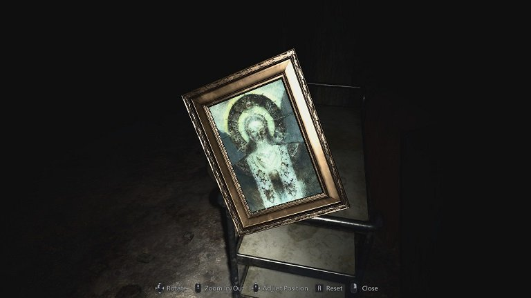 Resident Evil Village Walkthrough Guide – Part Three - The Picture frame contains a photo of a religious figure